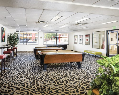Indoor recreation room with two pool tables.