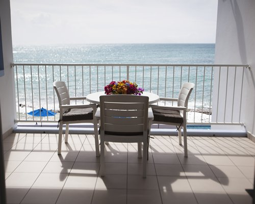 Balcony with patio furniture and a view of the bay.