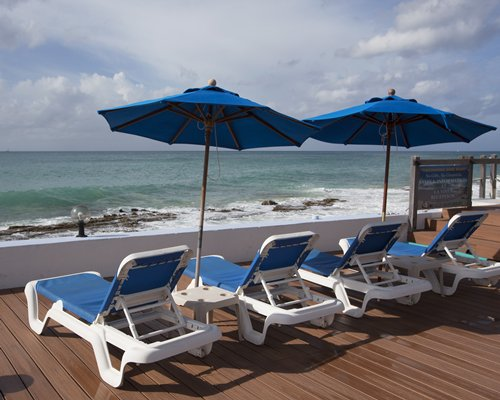 A view of chaise lounge chairs facing the bay.