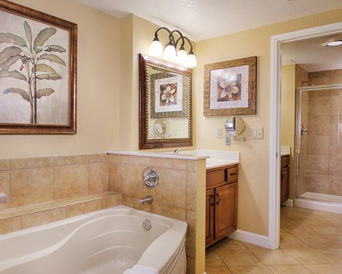 A bathroom with shower bathtub and a single sink vanity.