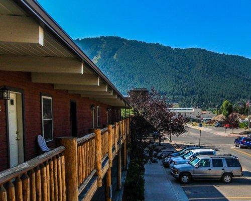 An exterior view of Jackson Pines resort alongside a parking lot.