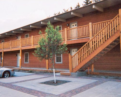Exterior view of a unit at Jackson Pines with balcony and stairway.