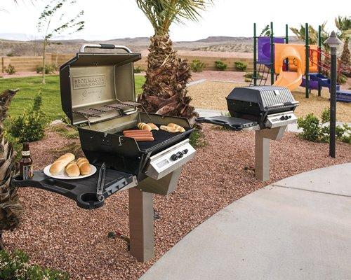 Barbecue grill alongside kids play area.