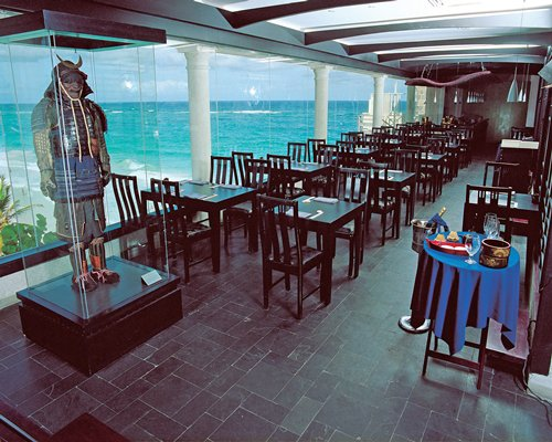 A well furnished indoor fine dining restaurant with a waterfront view.
