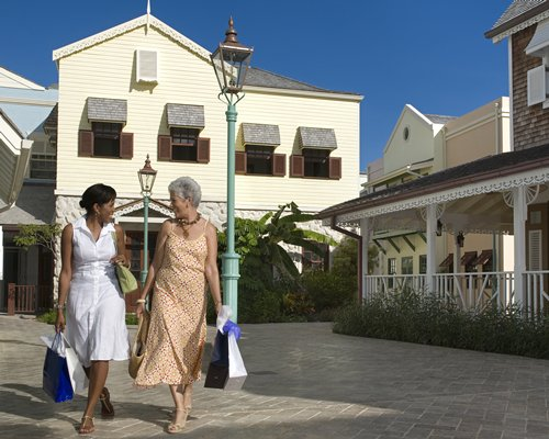 View of two ladies walking in front of The Crane Residential Resort.