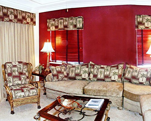A well furnished living room with queen pull out sofa.