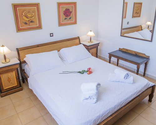 A well furnished bedroom at Corfu Residence.