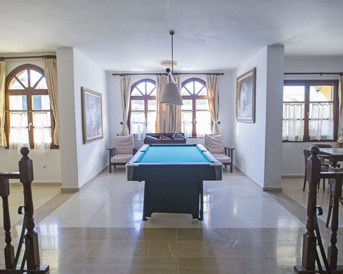 Indoor recreation area with pool table.
