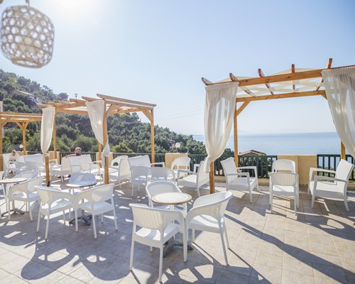 Outdoor restaurant with a view of the sea.