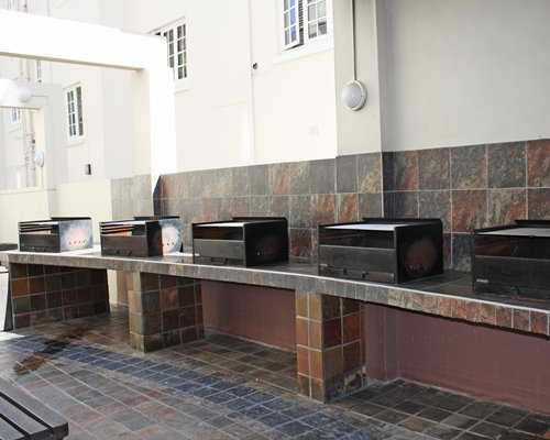 View of mutiple barbecue grills.