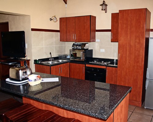A well equipped kitchen with stove and refrigerator.
