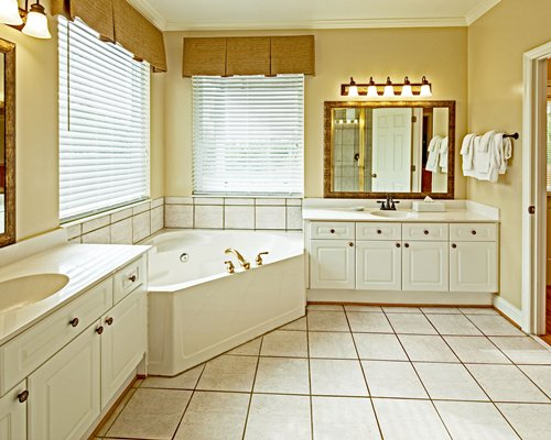 A bathroom with bathtub shower and closed sink vanity.