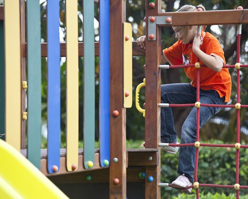 A kid playing in the playscape.