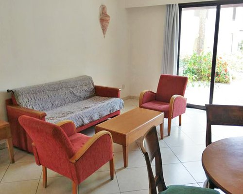 A well furnished living room with double pull out sofa and patio.