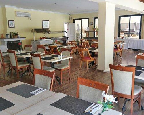 Indoor restaurant at Panareti Pafos Resort.
