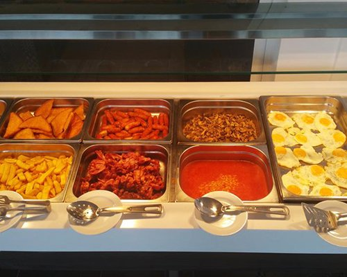 A view of various foods in buffet dining.