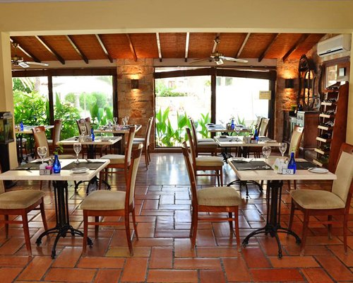 A well furnished restaurant with an outside view.