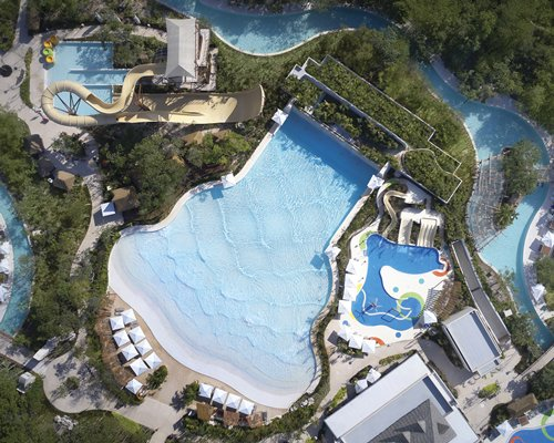 An aerial view of an outdoor swimming pool.