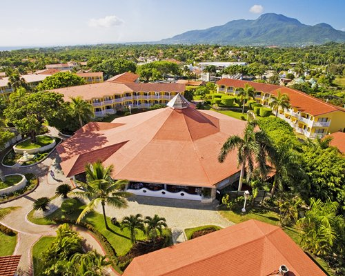 An aerial view of Resort with mountain and trees.