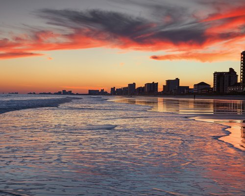 Sunset over silhouetted buildings at North Myrtle Beach.