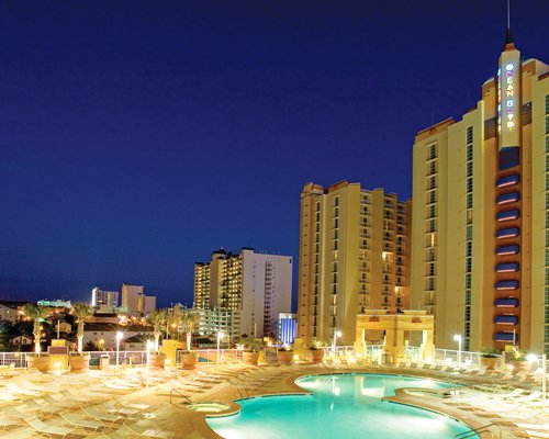 Evening exterior view of Wyndham Ocean Boulevard Resort showing pool area.
