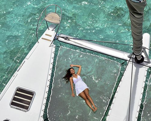A woman on a sailboat in the o