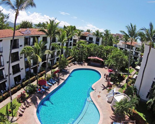Aerial view of Puerto de Luna All Suites Resort with an outdoor swimming pool.