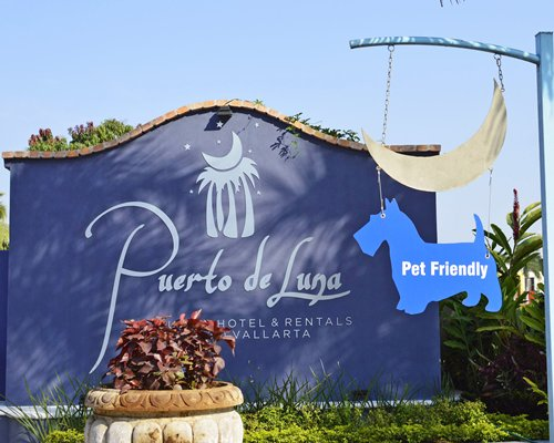 Signboard of Puerto de Luna All Suites Resort.