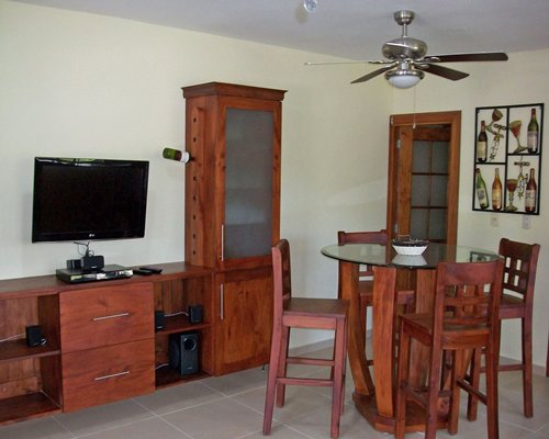 A well furnished dining room with a television.