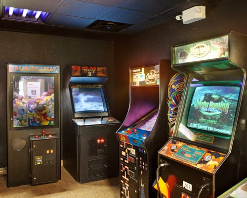 A recreational room with an arcade games.