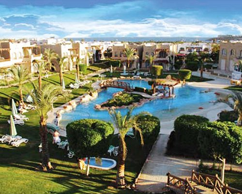 A large outdoor pool and hot tub alongside the Sharm Dreams Vacation Club.