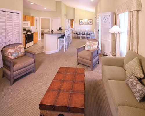 An open floor plan interior living dining and kitchen area.