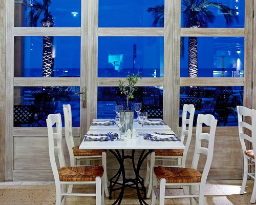 Restaurant with outside view at Plaza Spa Apartments.