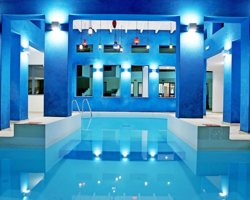 An indoor swimming pool at Plaza Spa Apartments.