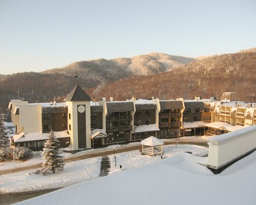 Exterior view of the Bolton Valley Resort Lodge during winter.
