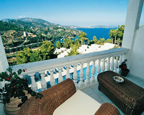 Balcony with lounge area and a view of the sea.