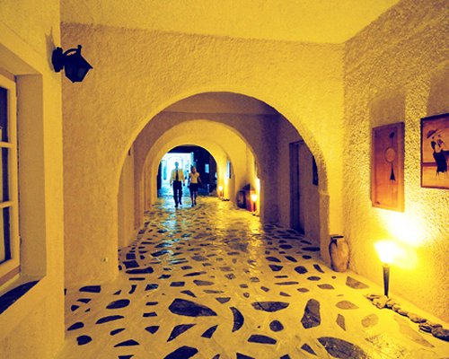 Night view of a corridor at the Nostos Resort.