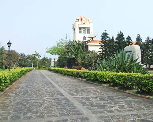 A scenic pathway leading to the Noble Yacht Club  Hainan resort.