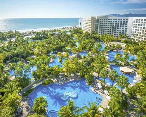 The Grand Mayan at Vidanta Nuevo Vallarta's outdoor swimming pool alongside the beach.