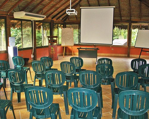 Outdoor meeting room with a projector.