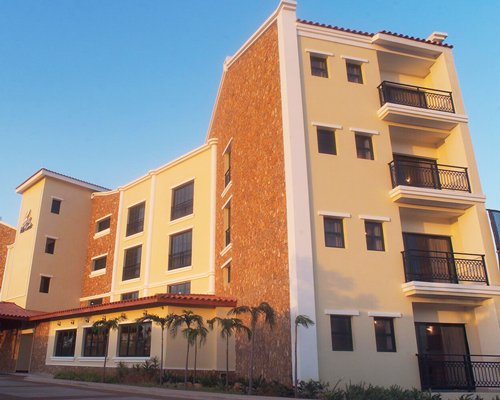 A ground view of the multi story condo.