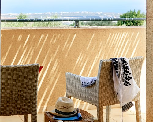 A balcony with patio furniture.