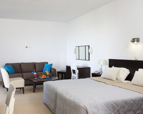 A well furnished living room with a twin bed.