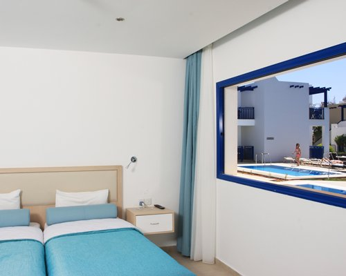 A well furnished bedroom with outside view.