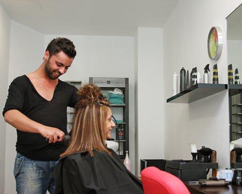 A woman at a salon.