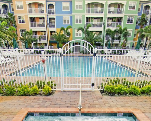 Outdoor swimming pool and hot tub alongside the Mizner Place at Weston Town Center.