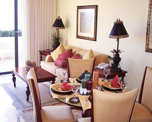 A well furnished living and dining area with an outside view.