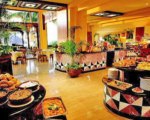 A well furnished indoor restaurant with a buffet.
