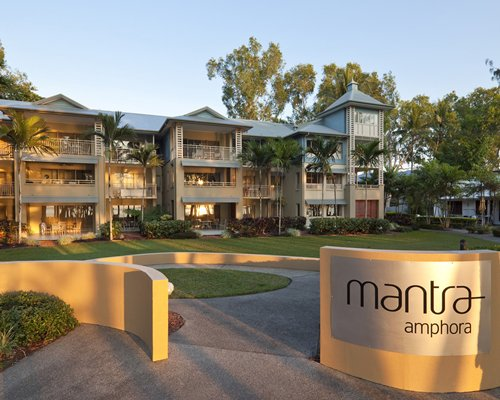 An exterior view of the Mantra Amphora resort with a signboard.