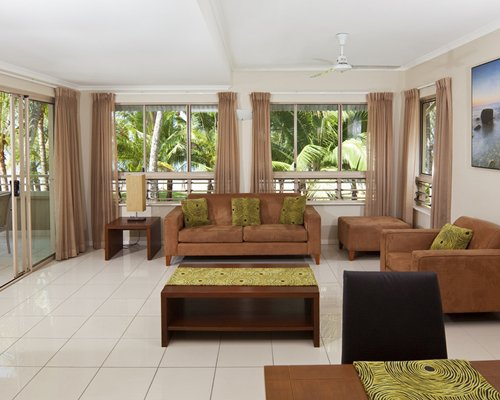 An indoor well furnished lounge area with an outside view.